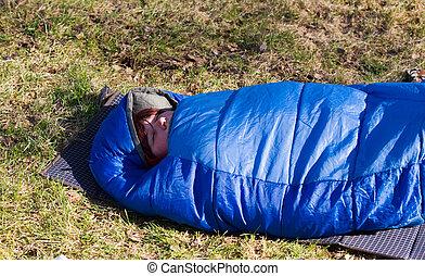 tourist in a sleeping bag