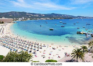 The tourists enjoiying their vacation on the beach, Mallorca, Spain