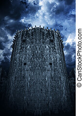 The tower of a medieval castle against a cloudy sky background.