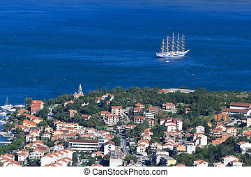The town of Kotor in Montenegro and sailing ship