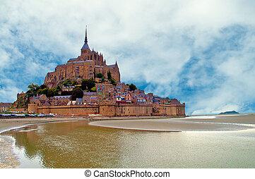 Mont Saint Michel - The town of Mont Saint Michel on the...