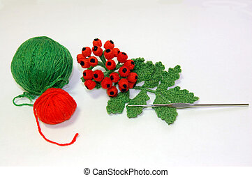 The toy connected by a hook - a branch of a mountain ash with balls of threads