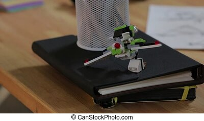 The toy constructor airplane on the table