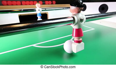 the toy football player scores a goal