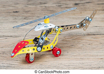 The toy metal helicopter