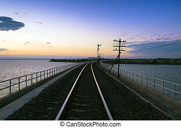 the track of railway or railroad with the morning twilight sky before the sunrise