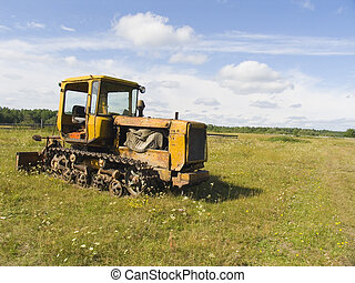 The tractor ploughs a field
