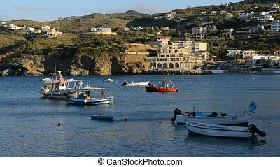 The traditional Greek boats for fishing near beach at...