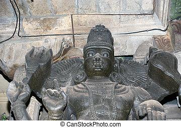 The traditional Hindu religion sculpture. Inside of Meenakshi hindu temple in Madurai, Tamil Nadu, South India.
