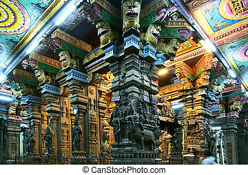 The traditional Hindu religion sculpture. Inside of Meenakshi hindu temple in Madurai, Tamil Nadu, South India.