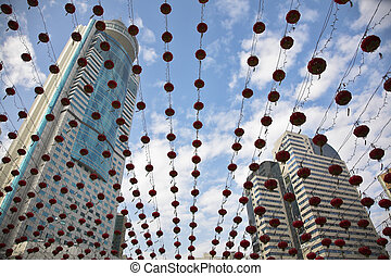 The traditional red lanterns decorating skyscrapers in China