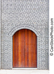 The traditional  wooden arched door and brick wall,which has the style of typical architecture of southern China in the Late Qing Dynasty . Three lanes and seven alleys, Fuzhou,China