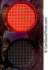 The traffic light at the pit lane.