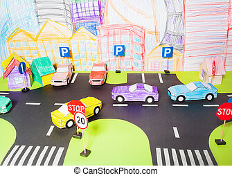 The traffic on a roads handmade paper maquette in driving...