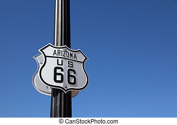 The traffic sign on a metal column,
