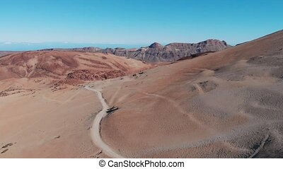 The trail at the foot of the volcano in the middle of the desert, view from the top. Tenerife, Spain