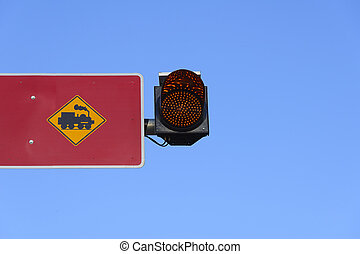 The train warning  sign with traffic light