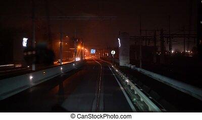 The tram rides across the bridge