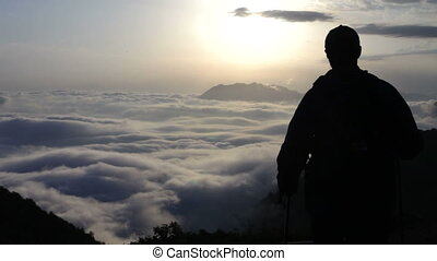 The traveler, mountains and clouds