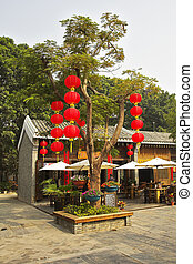 The tree decorated by garlands of red lanterns in the Chinese