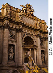 The Trevi Fountain with the statue of Neptune at the end of the day in Rome