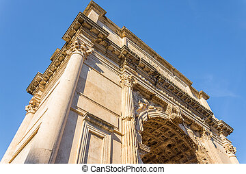 The Triumphal Arch of Titus in the Roman Forum, Rome, Italy....