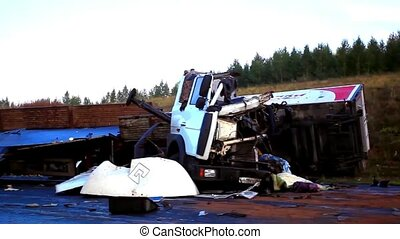 The truck lies in a ditch after the road accident