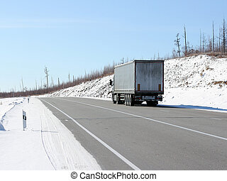 The truck on a winter road.