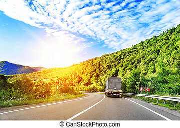 The truck on highway. - Country highway and a truck at ...