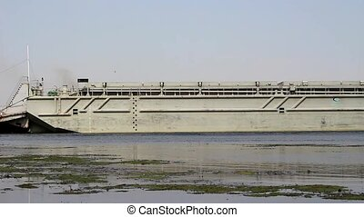 The tug moves an empty barge - A rusty tug, moves the barge,...
