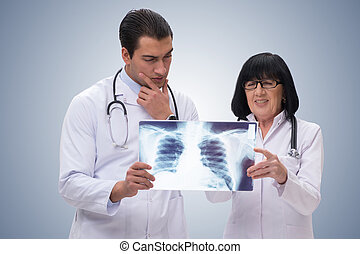 The two doctors looking at x-ray image