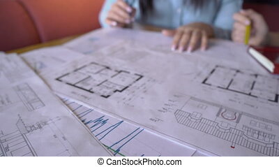 The two female realtors research the house plan while...