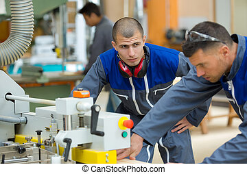 the two industrial woodworking workers