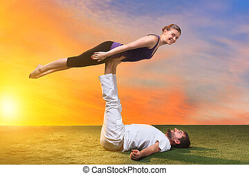 The two people doing yoga exercises