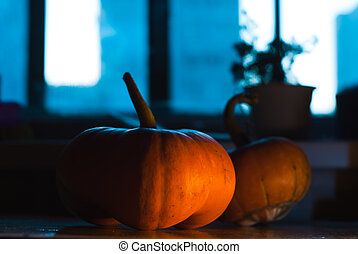 The two pumpkins on the table at night,