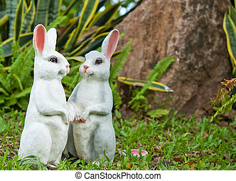 The two rabbit dolls in the garden