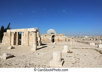 the Umayyad monumental gateway with the ruins of the mosque on the Citadel Hill in Amman, Jordan
