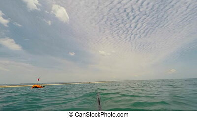 The underwater hunter returns to buoy. After diving. - The...