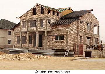 The unfinished house.