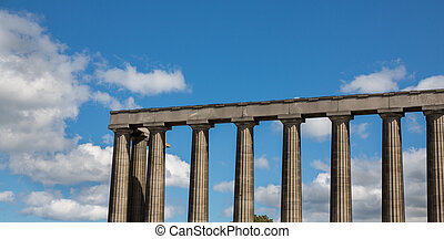 The unfinished National Monument in Edinburgh against blue...