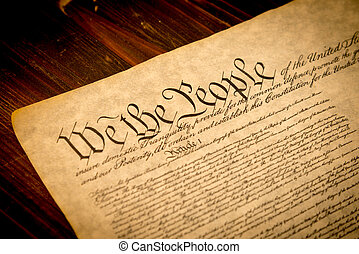 The United States Constitution on a wooden desk - The...
