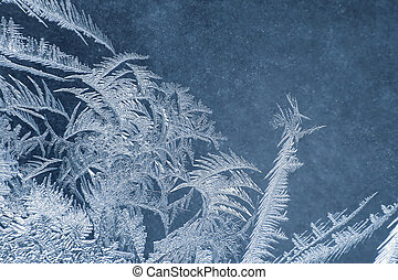 the unusual frost on a winter window. Seasons of nature and uniqueness