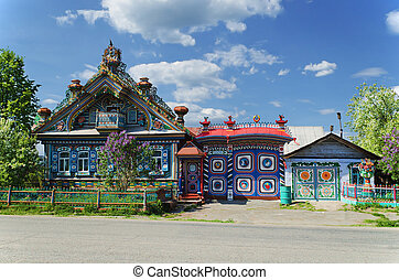 The unusual house in the Russian village in a sunny day in the summer