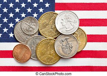 U.S. coins on American Flag