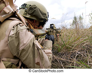 The US Marine In Action Shooting The Enemy