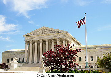 The US Supreme Court in Washington DC with American flag