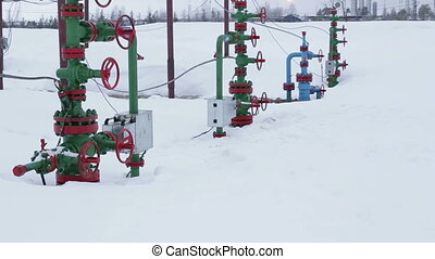 The valves at the wellhead production. In the background...