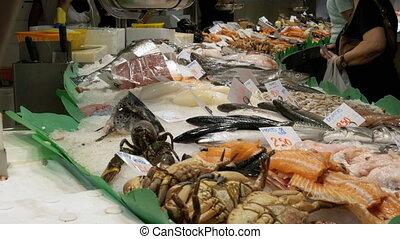 Vendor at the Store Counter with Seafood in La Boqueria Fish...