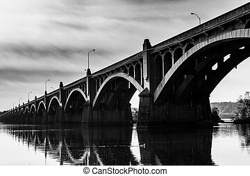 The Veterans Memorial Bridge reflecting in the Susquehanna...