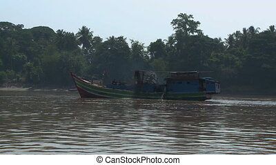 The view from a motorboat passing by a pump boat - A...